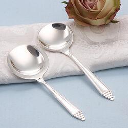 Zilveren suikerschep en theeschep