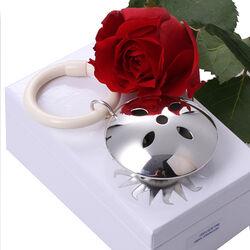 Zilveren rammelaar rond bloem ajour