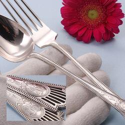 Zwaar zilver dinercouvert met luxe parelrand