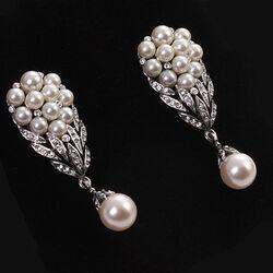 Zilveren oorstekers met kristal en glasparels