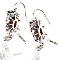 zilveren oorbellen rookquartz en markasiet