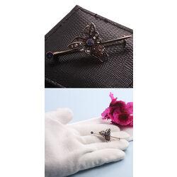 Gouden broche met diamant, saffiertjes en robijntjes