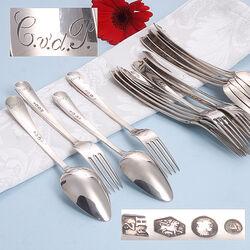 Zilveren dessertcouverts gegraveerd