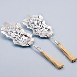 Stel zilveren natfruitscheppen uit 1852