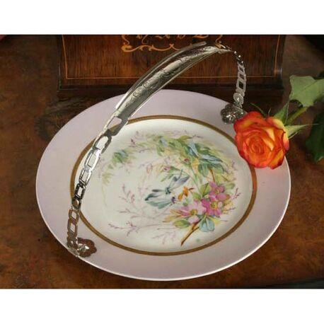Antiek bord porselein met zilveren beugel