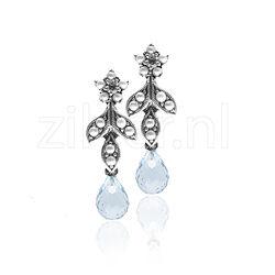 Zilveren oorbellen met topaas en pareltjes
