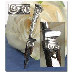 zilveren miniatuur mesje met leren schede