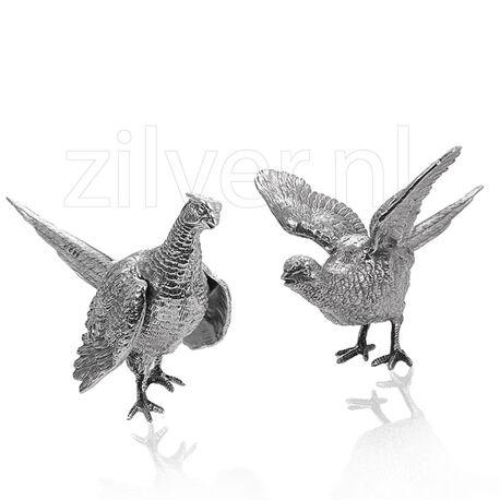 Zilveren tafelstukken fazanten