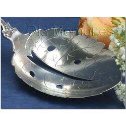 Flinke zilveren natfruitschep