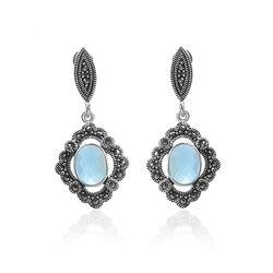 Zilveren markasiet oorbellen met topaas blauw zirkonia
