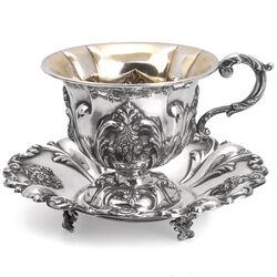Antieke zilveren kop en schotel
