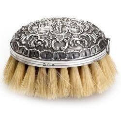 Zilveren kledingborstel van Greup