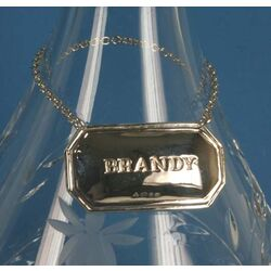 Zilveren brandy label van Carrs