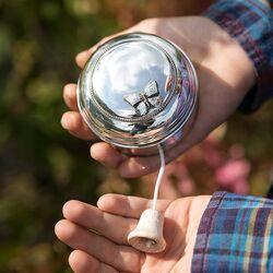Zilveren speeldoos parelrand en vlinder