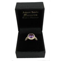 Gouden ring met grote amethist en vele briljanten