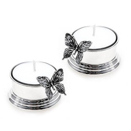 Stel zilveren waxinelichthouders met vlinder