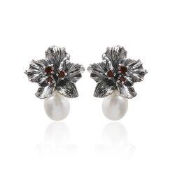 Zilveren oorstekers bloem met granaat