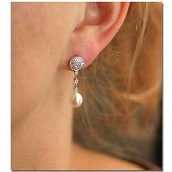 18 Karaats witgouden met diamanten en parel
