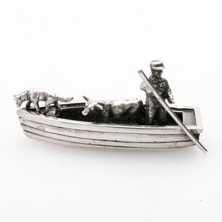 Miniatuur roeiboot met koe en hond