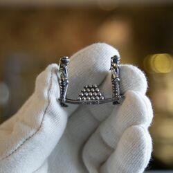 Kaasdragers miniatuur zilver