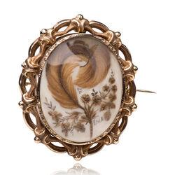 Antiek gouden broche met haarwerkje