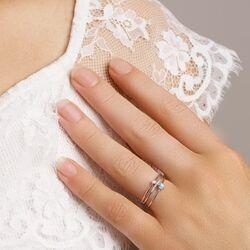 Witgouden ring bezet met blauw topaas