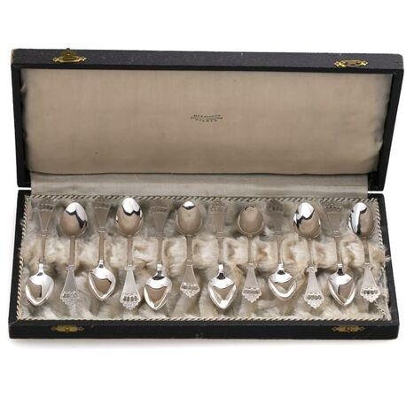 12 zilveren lepeltjes Huisman