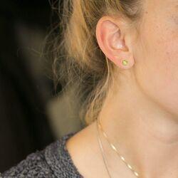 Gouden oorstekers peridot