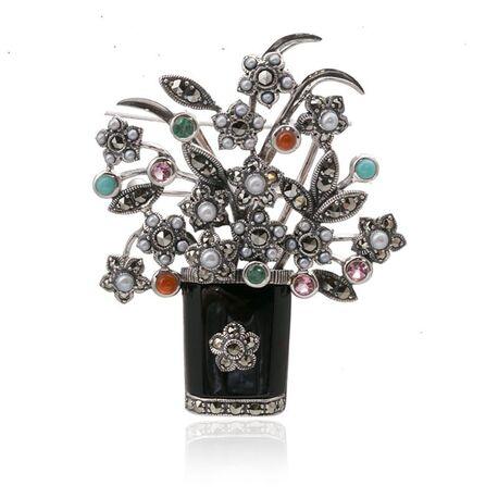 Zilveren bloemenmand broche markasiet edelstenen
