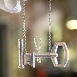 antieke zilveren breipenhouder sleutel