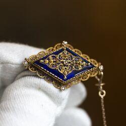 Antieke gouden streekbroche met parels en blauw glas