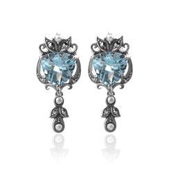 Zilveren oorbellen met blauw topaas