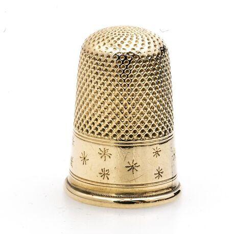 Gouden vingerhoed 19e eeuws met ster motief
