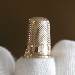 Gouden vingerhoedje