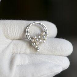 Occasion witgouden broche met parels en diamant