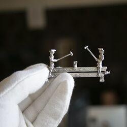 Miniatuur zilveren zagemannen Zwanenburg Sneek