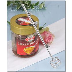 zilveren honinglepel met bijtjes op de steel van Raspini