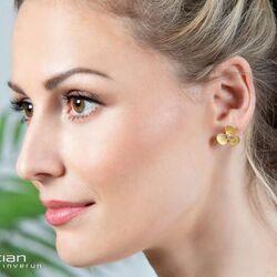 Bastian Inverun vergulde oorstekers bloem met diamantje