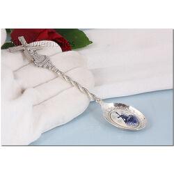 Verzilverde theelepel molen en blauw wit emaille molen
