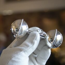 Juweliersrestant zilveren halter rammelaar parelrand