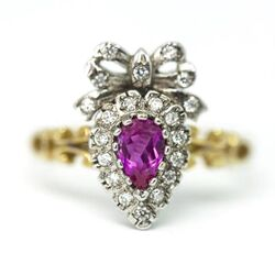 Gouden ring hart met strik robijn en diamantjes Engeland