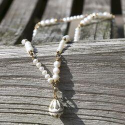 Tatiana Fabergé set lang collier met witte eihanger zirkoon