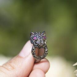 Zilveren ring panter met markasiet en robijn