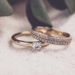 Geelgouden ring met briljant in strakke pavézetting