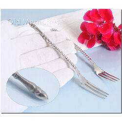 stel zilveren zuurvorken