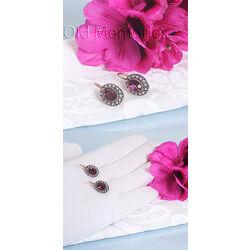 paarse oorbellen met pareltjes
