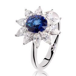 witgouden ring met saffier en peervormige diamanten