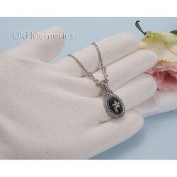 Zilveren ketting met onyx parels en markasiet